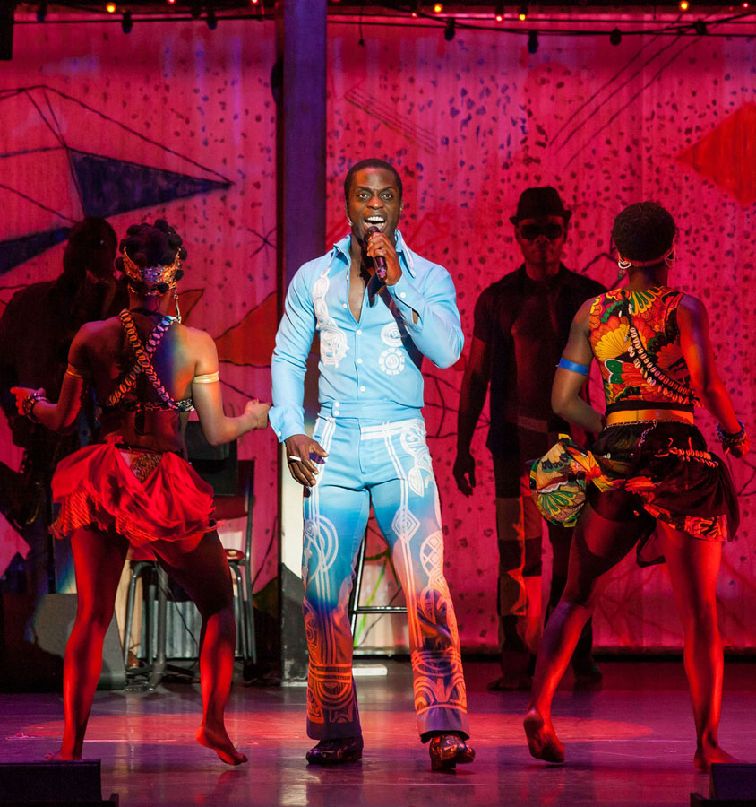 IN MOTION: Adesola Osakalumi (center) and the cast of 'Fela!' do their thing on stage. (Photo courtesy Sharen Bradford)