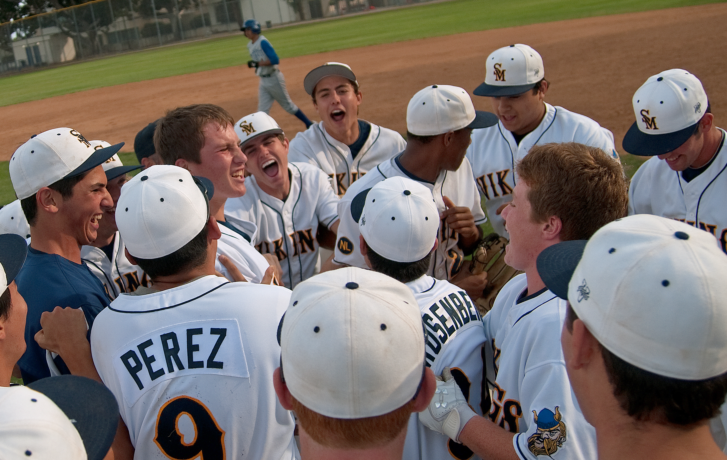 Samohi players celebrate after beating Culver City on Thursday at home. (Photo by Morgan Genser)