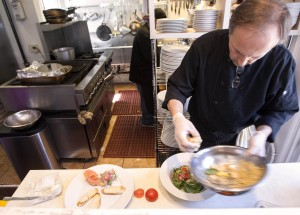 Chef and owner Art Selimovic prepares a salad for a customer at The Courtyard Kitchen on Montana Avenue. (Michael Yanow editor@smdp.com)