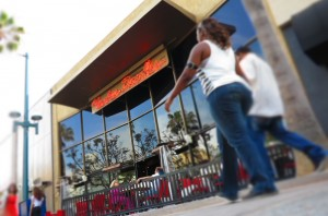 Shoppers walk past Yankee Doodle's on Friday afternoon. (Photo by Brandon Wise)