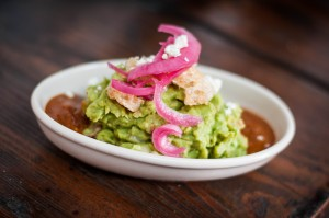 Nueske's apple-smoked bacon and chicharrones mingling with fresh avocados make up Tinga's bacon guacamole. (Photo courtesy Tinga)