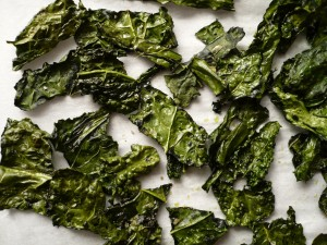 Instead of reaching for the Cool Ranch Doritos, try a healthier option by baking some nutritious kale chips with some olive oil and sea salt or create your own marinade. (Photo courtesy Google Images)