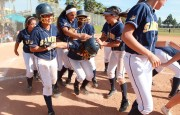 Santa Monica's softball team mobs teammate Sara Garcia after she hit her second home run of the game against No. 1 seeded Segerstrom on Tuesday on the road. Samohi went on to win the CIF-Southern Section Division 4 playoff game, 7-2. (Photo courtesy Wendy Perl)