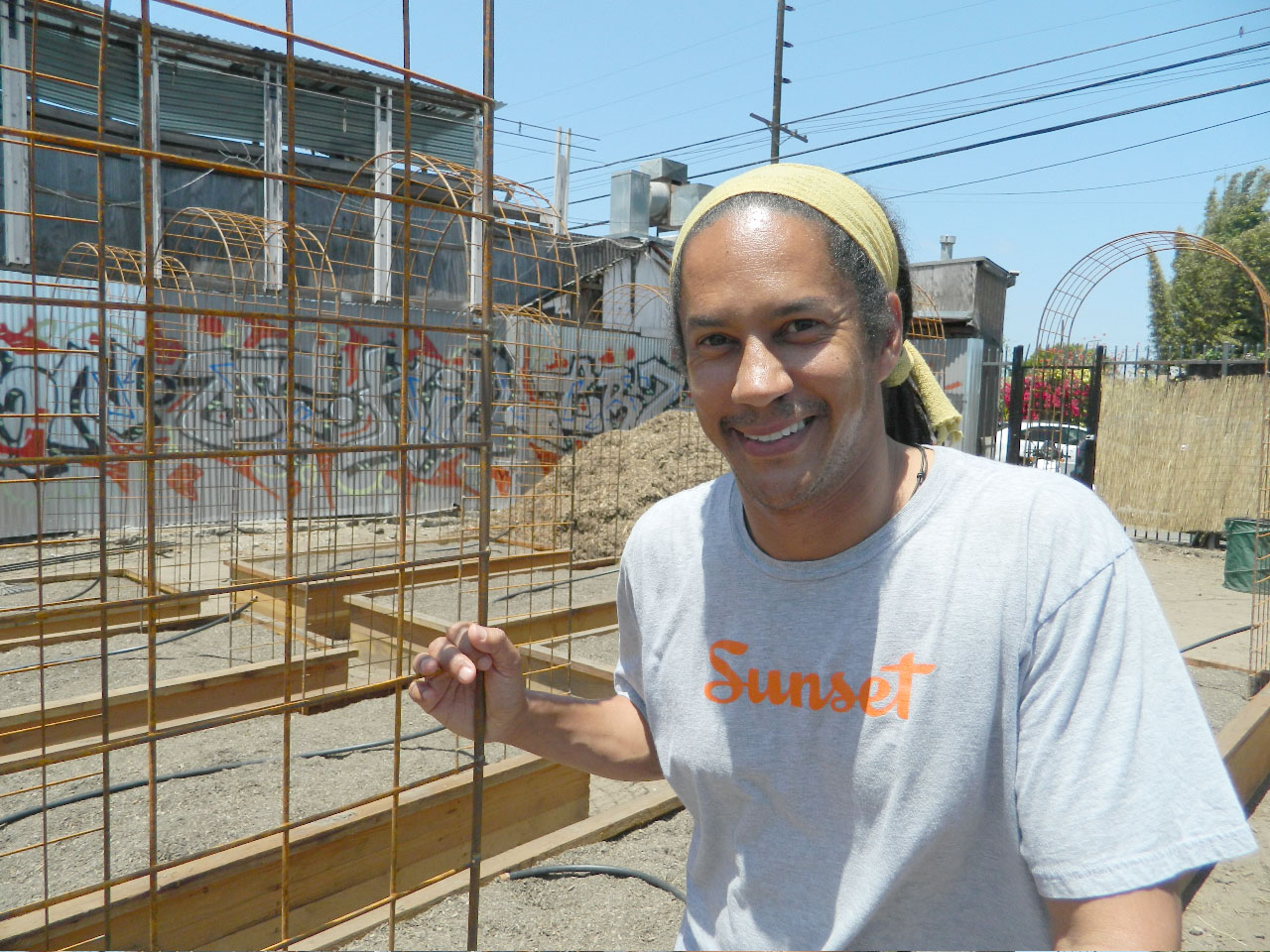 Chef Govind Armstrong poses at the future home of his chef's garden on Abbott Kinney. (Photo courtesy John Blanchette)