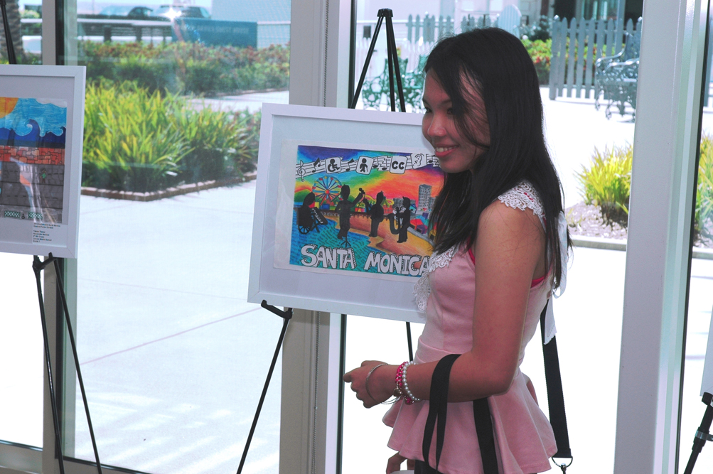 Samohi student Natthavadee Laoharangsima stands next to her award-winning poster. She and other local students participated in the fifth annual Sustainable Santa Monica Student Poster Contest, which focused on those with disabilities and how they enjoy nature with their family and friends.  (Photo courtesy city of Santa Monica)