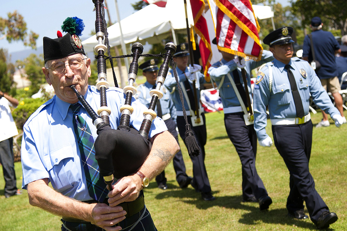 Highland bagpiper Thomas Allan plays during Woodlawn Cemetery's annual Memorial Day service. (Photo by Brandon Wise)