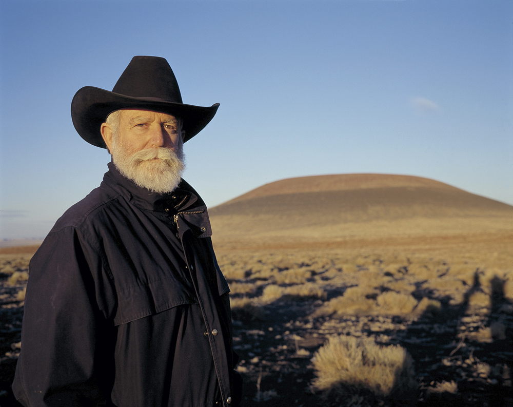 Artist James Turrell in front of his Roden Crater Project at sunset in October, 2001. (Photo courtesy Florian Holzherr/Los Angeles County Museum of Art )