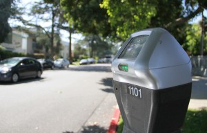 paying up: City Hall's Planning Department is considering a pilot program expanding the use of parking meters on select residential streets near major arteries like this one on 14th Street. (Photo by Daniel Archuleta)