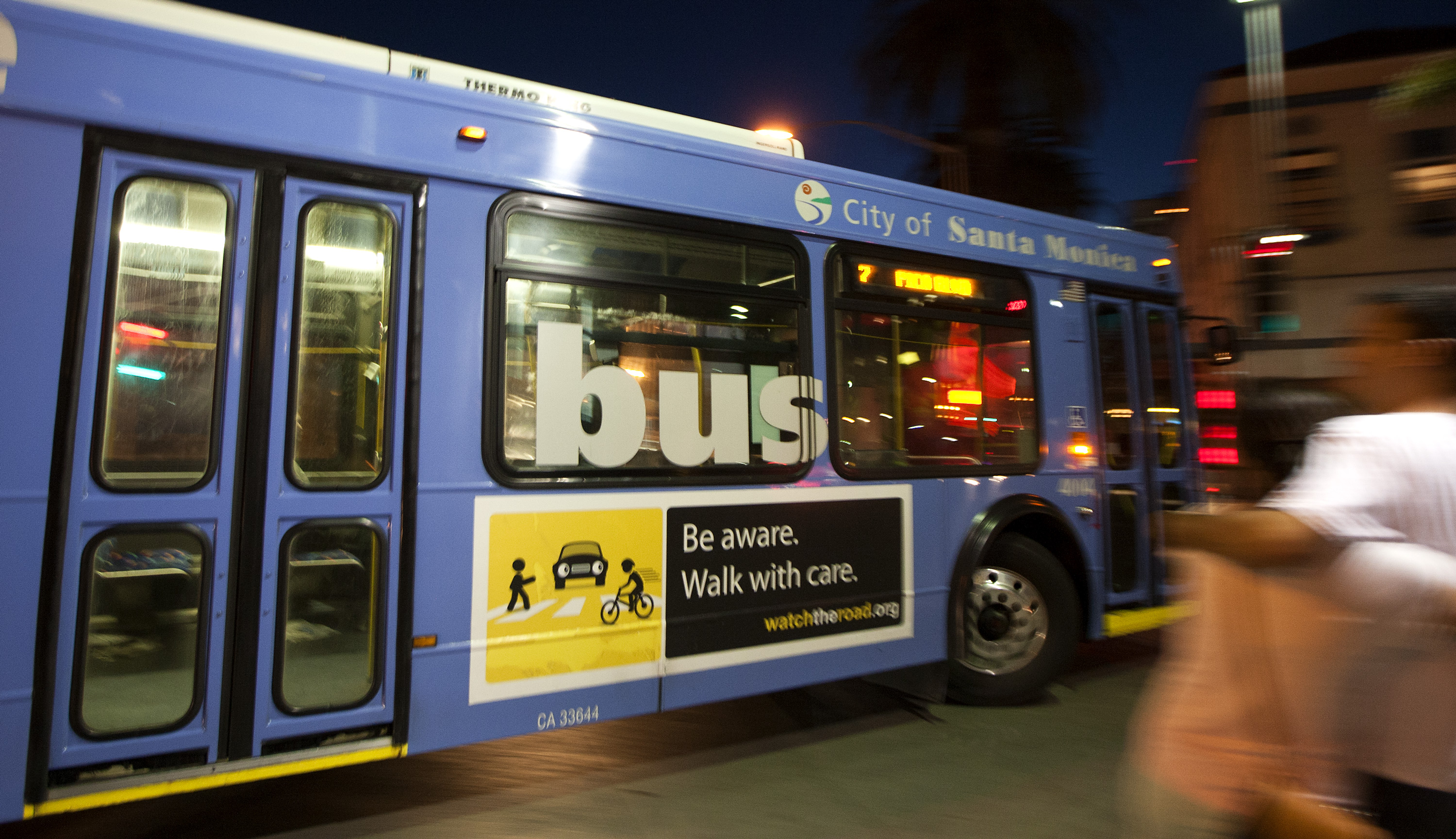 A Big Blue Bus makes a right turn onto Santa Monica Boulevard last month. The director of the bus company said big changes are needed.    (Photo by Michael Yanow)