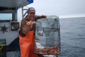 Fisherman Steve Escobar shows off his catch aboard the Ocean Pearl. (Photo courtesy Community Seafood)