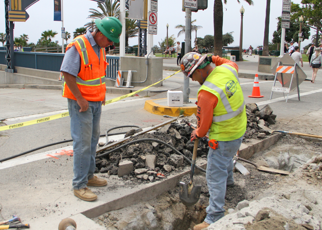 A small crew works on bringing water to the future site of Tongva Park. The park, located across Ocean Avenue from the enterance to the Santa Monica Pier, is slated to be completed later this year. (File photo)
