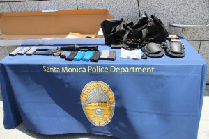 Weapons, ammunition and ammo clips found in a black bag carried by the suspect during the shooting rampage were put on display for reporters by the Santa Monica Police Department on Saturday during a press conference outside the Public Safety Facility.