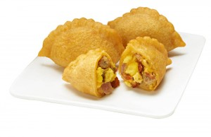 7-Eleven stores introduce 'Breakfast Empanada Bites' to capitalize on the snacking trend. The miniature pastries filled with eggs, cheese, bacon, smoked ham and sausage sell at a value price of three for $1 at participating locations. (Photo courtesy 7-Eleven)
