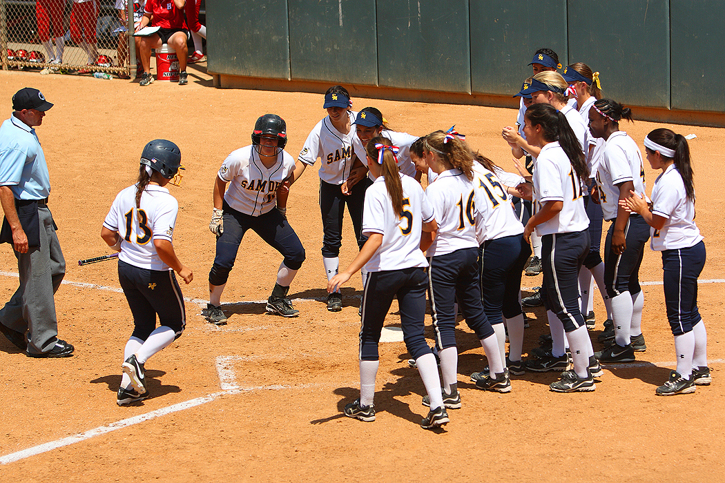COMING HOME: Samohi's softball team awaits Sara Garcia at home plate after she hit a home run in the CIF-Southern Section Division 4 final. (Photo by Wendy Perl)