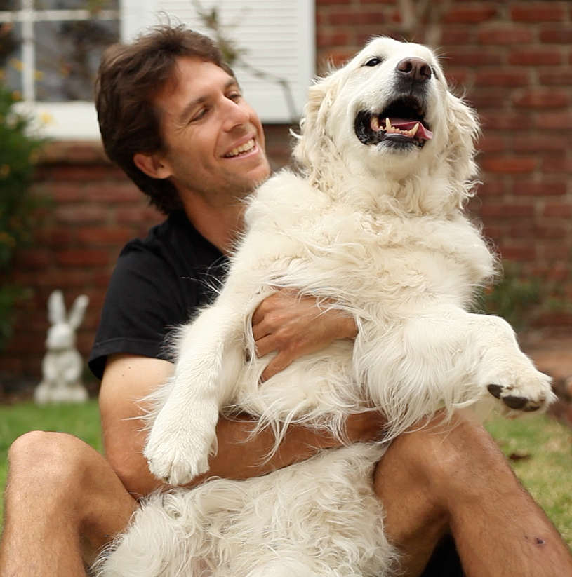 Josh Garrett plays with a friend's dog. (Photo courtesy Mercy for Animals)