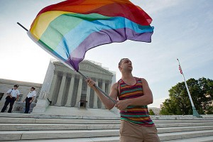 Gay rights advocate Vin Testa in front of the Supreme Court in Washington, Wednesday. Justices issued two major rulings on gay marriage cases. (Associated Press)
