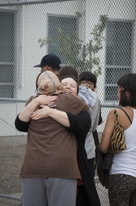 Two women hug after the shooting Friday afternoon at Santa Monica College.