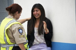 Priscilla Morales is consoled by a parking enforcement officer after being in the library at Santa Monica College where a gunman opened fire early Friday afternoon. (Photos by Paul Alvarez, Jr.)