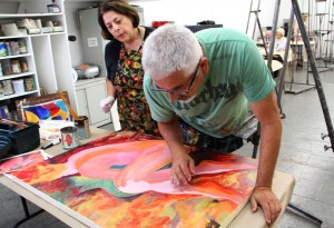 Student Billie Udko (left) looks on as instructor David Lloyd examines her work during an abstract painting class at the Brentwood Art Center on Tuesday. (Photo by Daniel Archuleta)