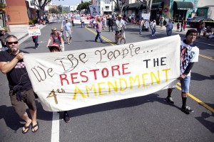 Members of the Restore the Fourth movement march along Main Street Thursday as part of the annual Fourth of July parade. (Brandon Wise brandonw@smdp.com)