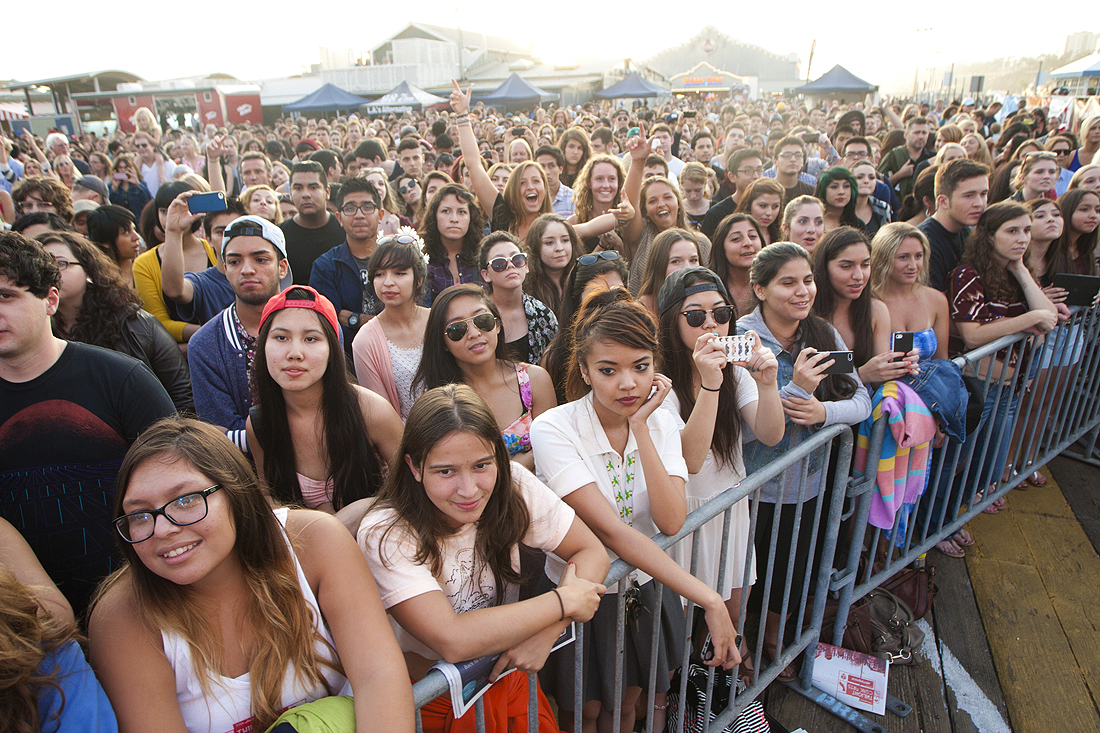 A crowd awaits Surfer Blood during the first week of the Santa Monica Pier's Twilight Concert Series. Several shows this season drew massive crowds, forcing public safety officials to shut down access. (Photo by Brandon Wise)