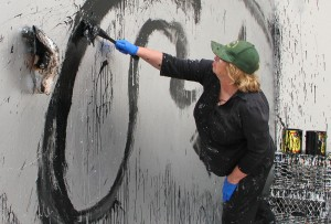 Artist Joyce Pensato works on a site-specific piece on  for her recent show 'I Killed Kenny' at the Santa Monica Museum of Art, which is located at the Bergamot Station Arts Center. (Photo by Daniel Archuleta)