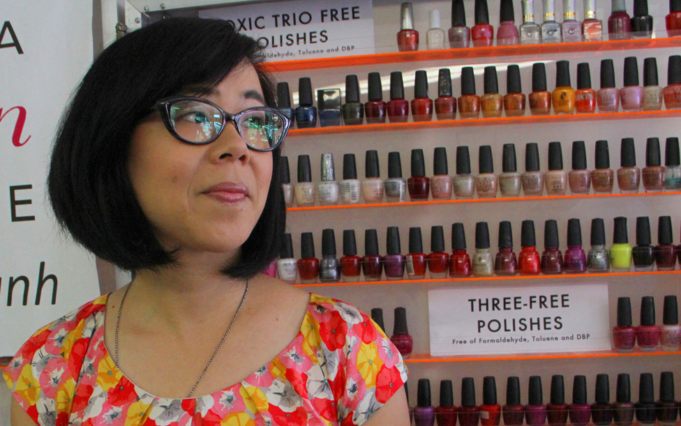 COLORFUL: Candice Kim, with the Coalition for Clean Air, stands in front of a display of non-toxic nail polish at Cute Nails on Tuesday. The coalition was on hand for the kick-off of the Healthy Nail Salon Program co-sponsored by Santa Monica's Office of Sustainability and the Environment. (Photo by Daniel Archuleta)