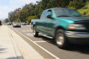 Cars streak past the Annenberg Community Beach House on Pacific Coast Highway on Monday. (Photo by Daniel Archuleta)