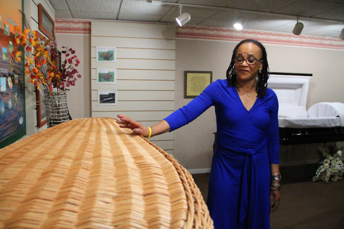 OPTIONS: Annette Smith, with Gates Kingsley & Gates Moeller Murphy Funeral Directors, discusses the benefits of being buried in a wicker casket on Tuesday. She said that the wicker models appeal to people who are concerned about the environment. (Photo by Daniel Archuleta)
