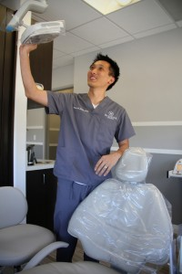 Dentist Peter Pham checks his examination room's equipment earlier this week at his office on Santa Monica Boulevard. (Daniel Archuleta daniela@smdp.com)