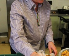 Kathy Osburn prepares meals for seniors at the Ken Edwards Center in May. (Daniel Archuleta daniela@smdp.com)