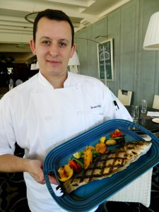 Sven Mede, executive chef at Catch in Casa del Mar beachfront hotel, with his grilled branzino and roasted vegetables. (Photo courtesy John Blanchette)