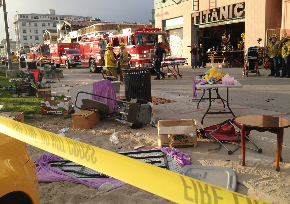 Los Angeles Fire Department personnel survey the aftermath of an incident that left one tourist dead in Venice on Saturday. (Photo courtesy Byron Kennerly)