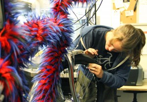 Mechanic Emily Sullivan works on a rather furry bike at the Santa Monica Bike Center on Thursday. (Daniel Archuleta daniela@smdp.com)