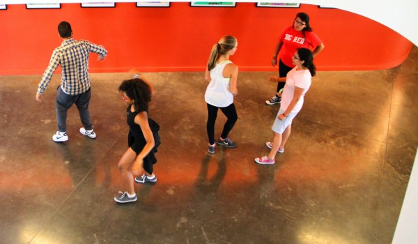 KIDS IN MOTION: New Roads students practice dance in the lobby of the new Capshaw-Spielberg Center for Arts and Educational Justice last week. The students are working with nonprofit dance group Contra Tiempo. (Daniel Archuleta daniela@smdp.com)