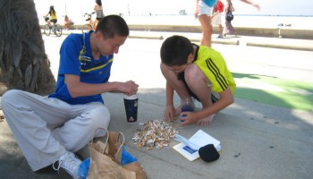 YUCK: A cigarette butt research team collects data along the beach boardwalk. (Photo courtesy Benjamin Kay)