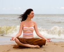 girl meditation in the beach