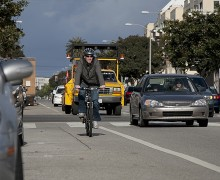 A man rides his bike on Broadway. (File photo)