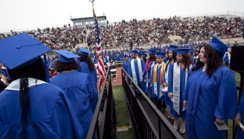 Students wave to their family members and friends as they wait to collect their deplomas during the Santa Monica College 2011 graduation ceremony at the Corsair Field. (File photo).