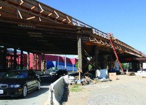UNDER CONSTRUCTION: Drivers go underneath the future Exposition Light Rail Line near Cloverfield Boulevard. (File photo)