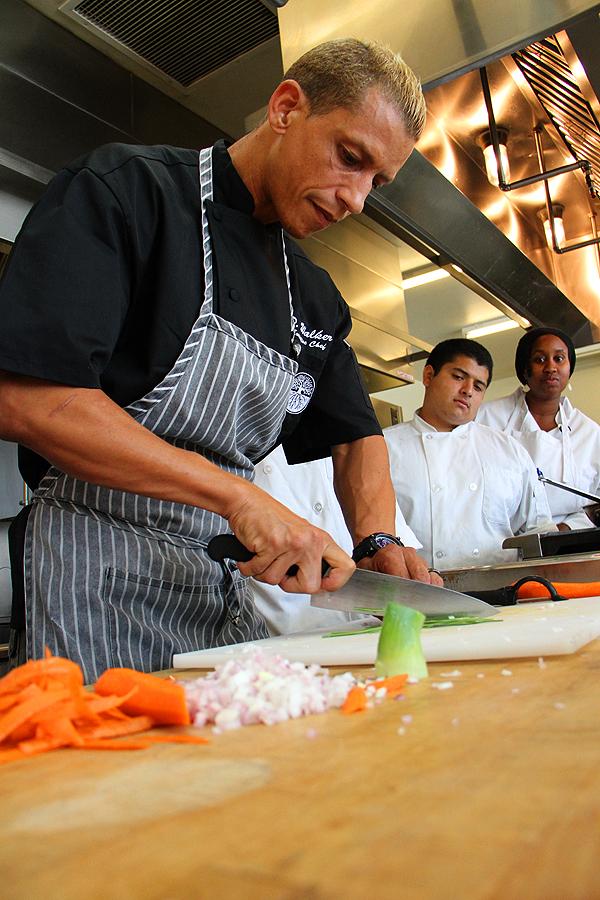CHOP, CHOP: St. Joseph Center's Chef D. Brandon Walker shows off his knife skills. (Daniel Archuleta daniela@smdp.com)