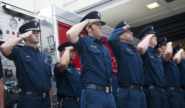 Fire Fighters gather at Fire Station 1 on Wednesday morning to remember those who lost their lives in the terrorist attacks of Sept. 11, 2001, including the public safety personnel who died while trying to rescue those trapped in the World Trade Center towers. (Brandon Wise brandonw@smdp.com)