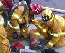 Santa Monica fire fighters revive Stella, a boxer, on Saturday using a specially designed mask made specifically for dogs.  (Photo courtesy Santa Monica Fire Department)