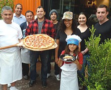 ANYONE HUNGRY? The staff of Bravissimo Café and Pizzeria on Main Street, including Jett, age 8. (Photo courtesy Bruno Marcotulli)