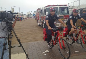 Santa Monica Fire Department personnel show off their emergency bikes on the Santa Monica Pier last week during a video shoot for CityTV, the local public access channel. (Photo courtesy Tamara Henry)