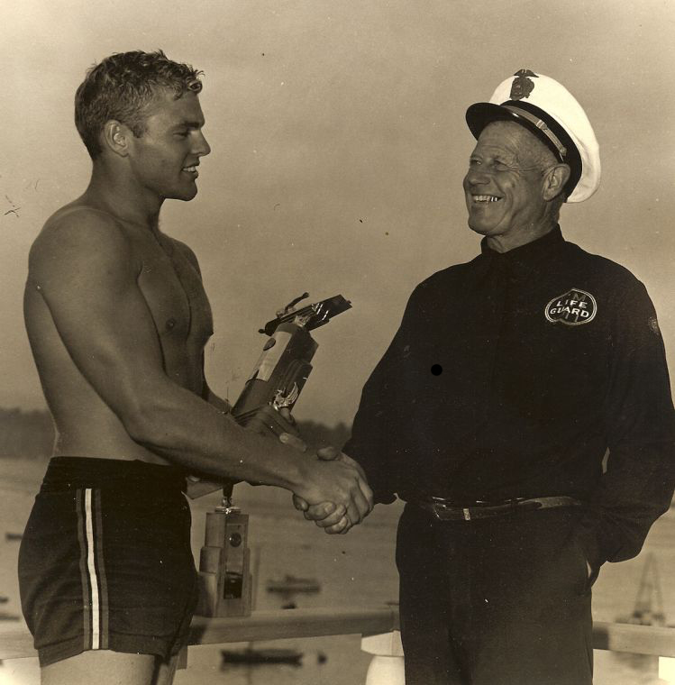 George 'Cap' Watkins (right) presents his friend Tom Zahn with a paddleboarding trophy. Zahn used to bring his girlfriend, Marilyn Monroe, to parties at Cypress Sea Cove, Watkins' idyllic Malibu retreat. (Photo courtesy Richard Mark)