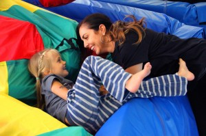 We Rock the Spectrum Santa Monica owner Debra Davis plays with Finley Rossi on Monday. (Daniel Archuleta daniela@smdp.com)