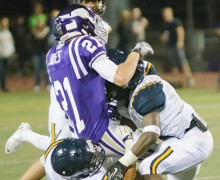 TAKE DOWN: The Santa Monica defense swarms Valencia's Nick Jones Friday night at Valencia. Samohi would go on to lose, 42-21. (Paul Alvarez Jr. editor@smdp.com)