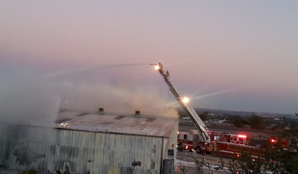 Fire fighters work to extinguish the blaze at SMO Sunday night. (Photo courtesy Ron Casa)
