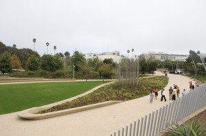 Members of the media take a tour of the 6.2-acre Tongva Park Monday.